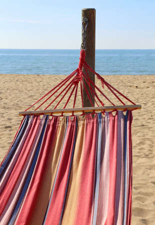 hammock for relaxing on the beach by the sea at the resort in summer