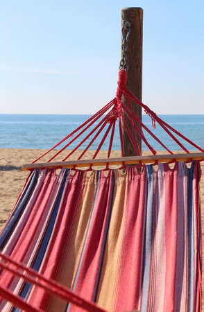 hammock for relaxing on the beach by the sea at the luxury resort in summer