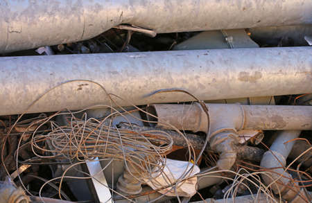 ferrous: rusty old iron pipes and other ferrous material in a landfill to recycle Stock Photo