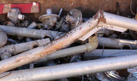 ferrous: rusty iron pipes and other ferrous material in a landfill