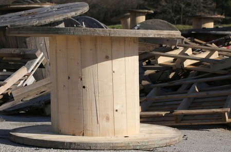 recyclable: many wooden reels for electrical cables in landfills for recyclable material