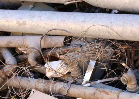 landfill: rusty old iron pipes in a landfill to recycle Stock Photo