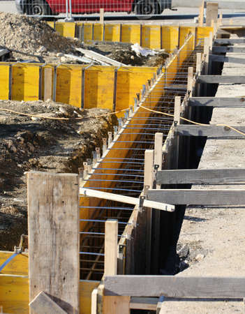 construction site for the construction of the walls of the house with reinforced concrete