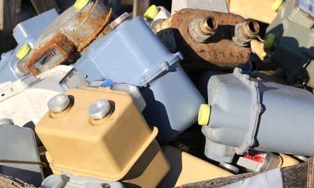 landfill: obsolete gas meters in a polluting material landfill Stock Photo