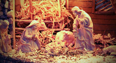 nativity set: Nativity scene with beautiful wooden statues and the manger with straw and the ox