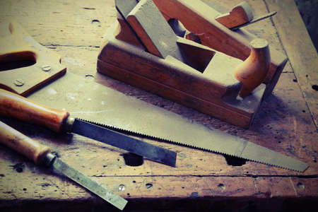chisels: planer and chisels and other tools in the ancient workshop of the carpenter Stock Photo