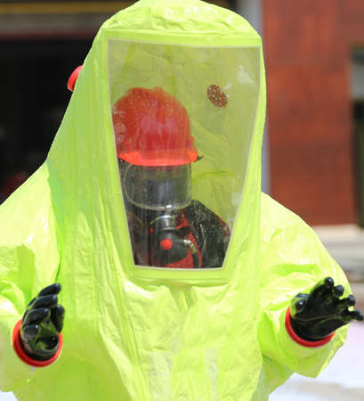 radiation protection suit: person with yellow overalls anti-contamination during an anti-terrorism exercise Stock Photo