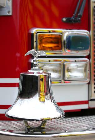 fire brigade: gleaming eagle symbol above the truck bell fire brigade American fire Stock Photo