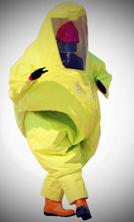 protective suit: person with protective suit with breathing apparatus and anti contamination filters against biohazard and white background