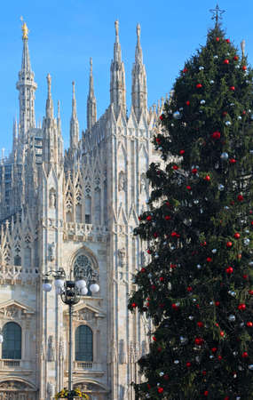 christmas ornamentation: big Christmas tree in front of the cathedral of milan in italy