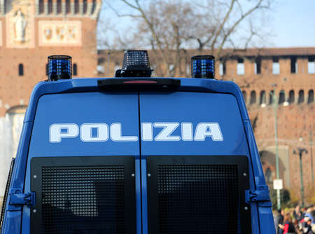 armored truck of the Italian police in checkpoint with big written that means POLICE in Italian