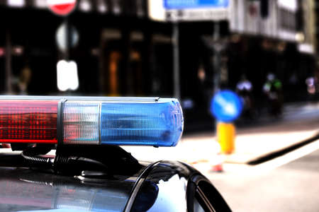 traffic warden: Red and blue flashing lights of the police car in the checkpoint at night