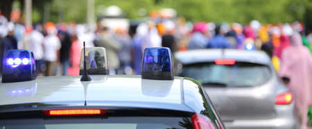 outcry: Police patrol car with flashing lights and a police car undercover in the city