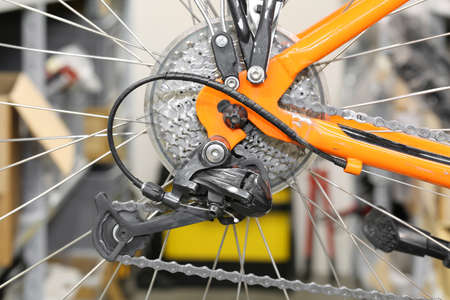 chain rings and rear derailleur of a orange bike