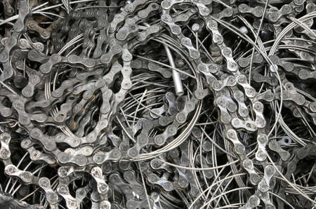 rummage: many pieces of chains and wires of bicycle brakes