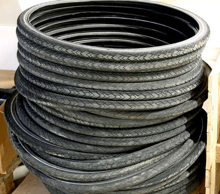 hazardous waste: pile of black used rubber tires for bicycles in the controlled landfill of hazardous waste