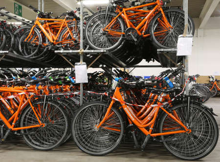 freewheel: Vicenza, VI, Italy - January 1st, 2017: huge warehouse with thousands of bicycles of the company Girolibero the principal european tour operator Editorial