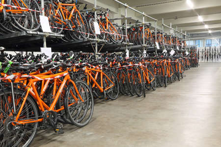 freewheel: Vicenza, VI, Italy - January 1st, 2017: warehouse with thousands of bicycles of the company Girolibero the principal european tour operator specialising in cycling holidays