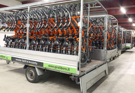 principal: Vicenza, VI, Italy - January 1st, 2017: tow trucks full of bicycles  of the company Girolibero the principal european tour operator specialising in cycling holidays Editorial