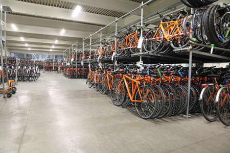 freewheel: Vicenza, VI, Italy - January 1st, 2017: huge warehouse with thousands of bicycles of the company Girolibero the principal european tour operator specialising in cycling holidays Editorial