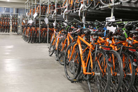 freewheel: Vicenza, VI, Italy - January 1st, 2017: big warehouse with thousands of bikes of the company Girolibero the principal european tour operator specialising in cycling holidays