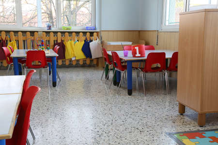 pedagogy: small tables with chairs and toys in a preschool for Children