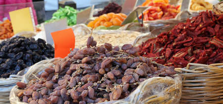 deglet: basket of dried dates and dried tomatoes for sale in vegetable market