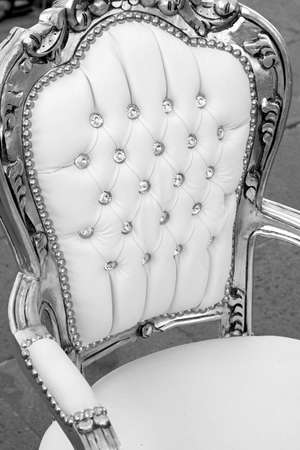precious ancient seat throne in white leather and diamond buttons with silver lining