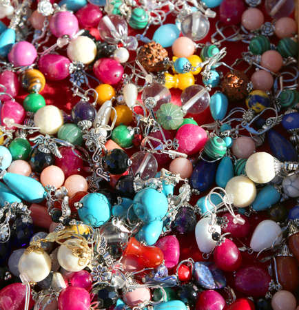 many antique pendants for necklaces for sale in flea market