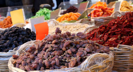 deglet: basket of dried dates and dried tomatoes for sale in vegetable market of Italy