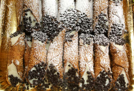 cannoli pastry: Sicilian pastry with many cannoli cream and dark chocolate chips Stock Photo