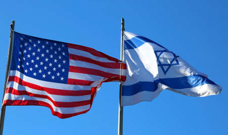 American flag and the Israeli flag in the blue sky