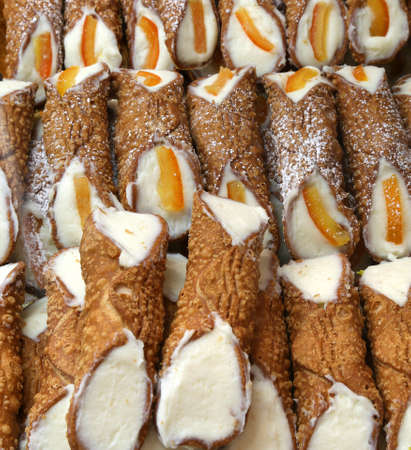 Sicilian pastry with many cannoli with ricotta cheese and slices of  orange