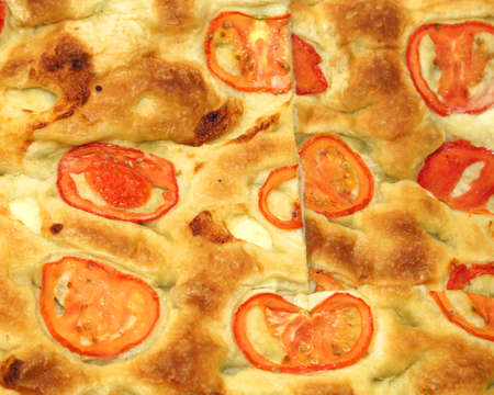 bread flatbread pizza with fresh tomato slices for sale by Italian baker