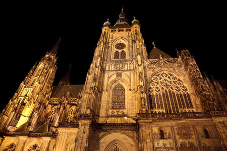 a nocturne: impressive facade of the Gothic cathedral of St. Vitus in Prague in the Czech Republic by night