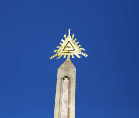 iconography: Obelisk and the symbol of the trinity with triangle and one big Eye of Providence Editorial