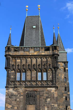 Detail of tower with battlements of the Charles Bridge in Prague Old Town in Czech Republic Europe Stock Photo
