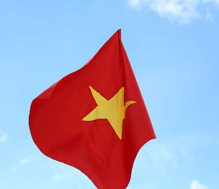 red flag of VIETNAM with the big yellow star on blue sky
