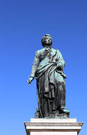 large statue of the great composer Mozart with the background of the blue sky