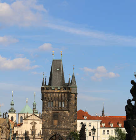 High tower with battlements from the Charles Bridge in Prague Old Town in Czech Republic Europe
