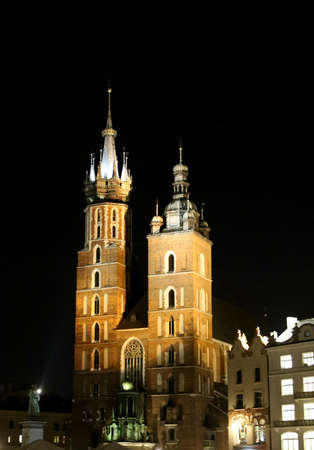 into: Church of Our Lady Assumed into Heaven in krakow Poland by night Stock Photo