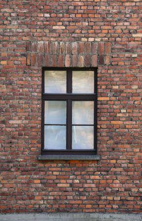 tragedies: old brick wall with a rectangular window