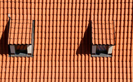 dormer: two Dormer on the roof with red roof tiles Stock Photo
