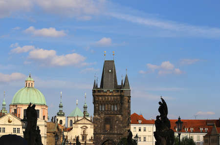 skyline of prague with the medieval tower of the Charles Bridge over the Vltava river in Czech Republic Europe