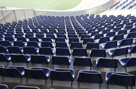 gradas estadio: many chairs with no spectators on the stadium bleachers