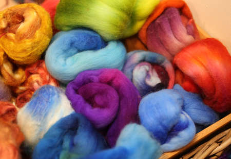soft sell: soft balls of colored wool to create trendy winter sweaters Stock Photo