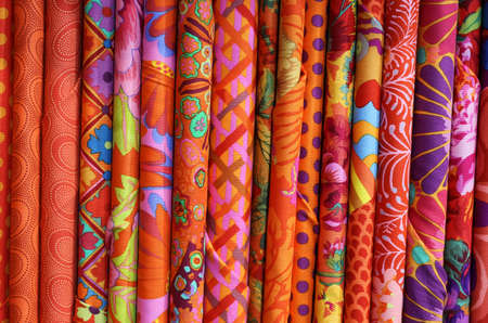selectively: many colored fabrics with a technique called BATIK. This is a technique of wax resist dyeing applied to whole cloth and and you can color the shapes individually and selectively Stock Photo