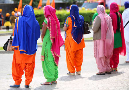 kameez: Many women with colorful dresses Along The Streets of the city