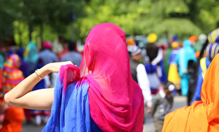 kameez: woman with headscarves icing during the event in the city