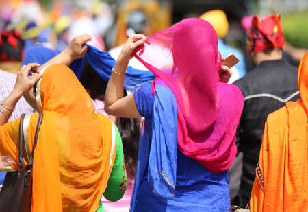 kameez: woman with headscarves during the event in the city Stock Photo